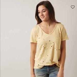 Golden Intent shirt from buckle.